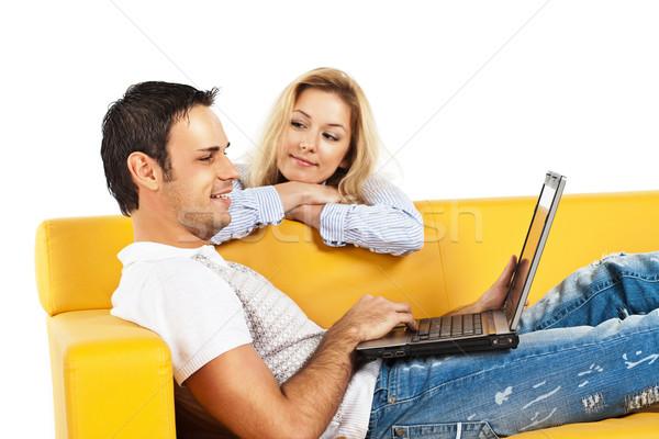 счастливым портативного компьютера молодым человеком женщину сидят Сток-фото © MikLav