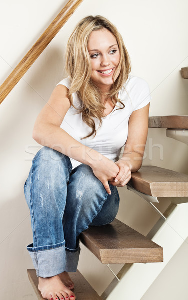 Fiatal nő ül lépcső csinos fiatal mosolygó nő Stock fotó © MikLav