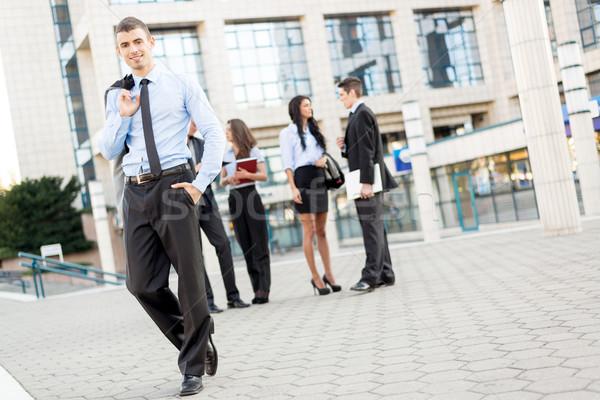小さな ハンサム ビジネスマン 笑みを浮かべて 立って オフィスビル ストックフォト © MilanMarkovic78
