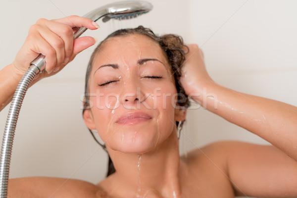 красивой молодые улыбающаяся женщина стиральные лице волос Сток-фото © MilanMarkovic78