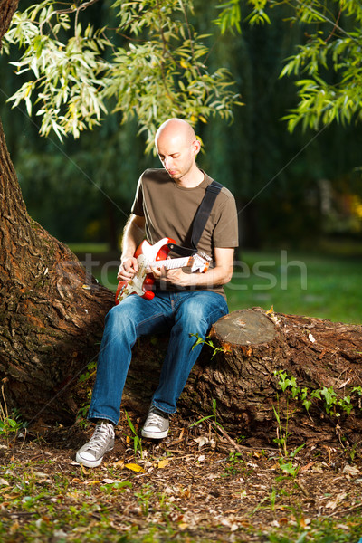 Guitarist in the park Stock photo © MilanMarkovic78