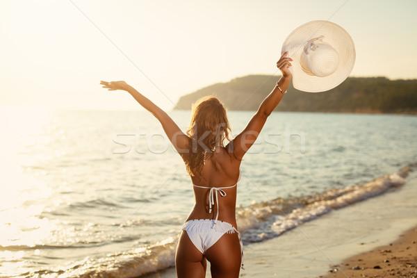 девушки расслабляющая пляж красивой купальник Сток-фото © MilanMarkovic78