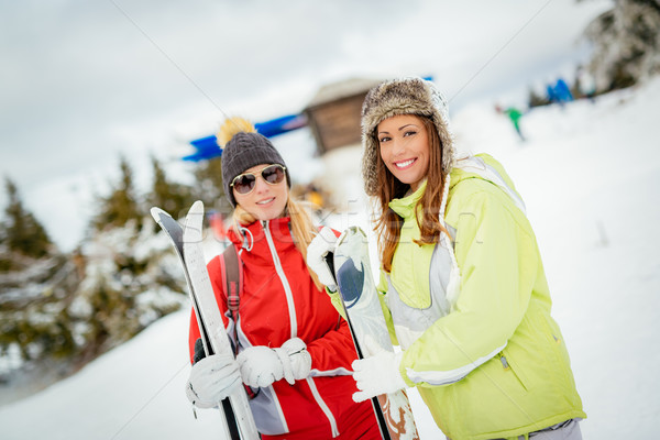 Girl Friends On Winter Vacation Stock photo © MilanMarkovic78