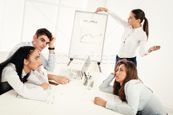Unalmas üzletemberek megbeszélés iroda fiatal üzletasszony Stock fotó © MilanMarkovic78