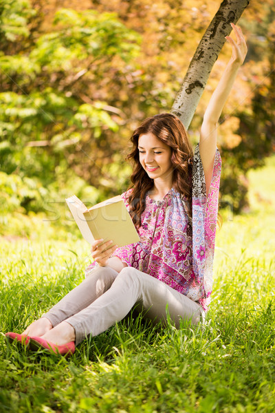 Happy Girl with a book in the park Stock photo © MilanMarkovic78
