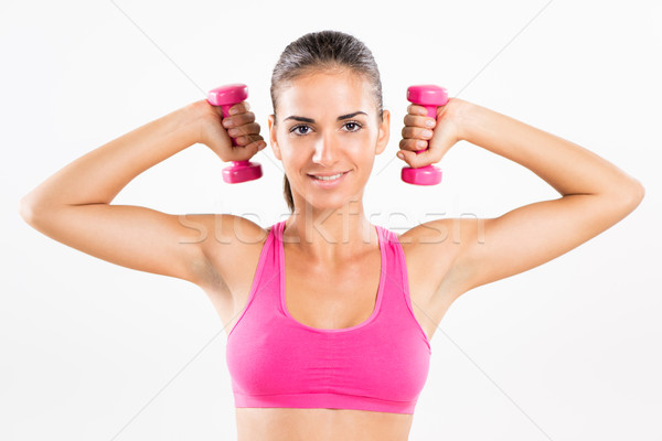 Stock photo: Fitness woman lifting dumbbells