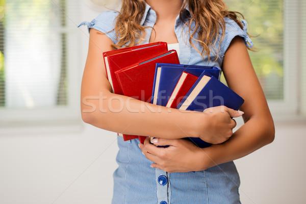 Sok könyvek ismeretlen lány tart könyv Stock fotó © MilanMarkovic78