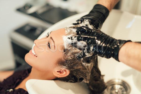 Közelkép férfi fodrász mosás haj nő Stock fotó © MilanMarkovic78