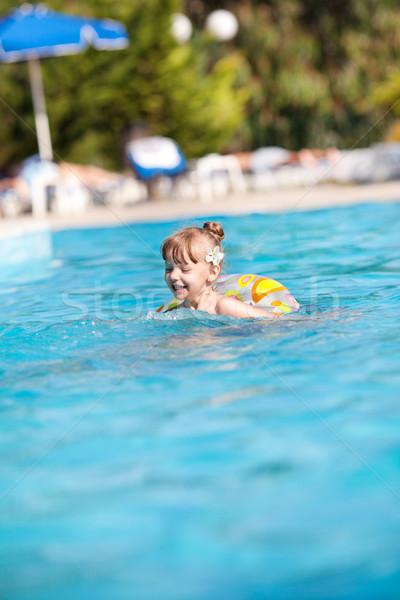 Boldog kislány medence úszómedence úszik cső Stock fotó © MilanMarkovic78