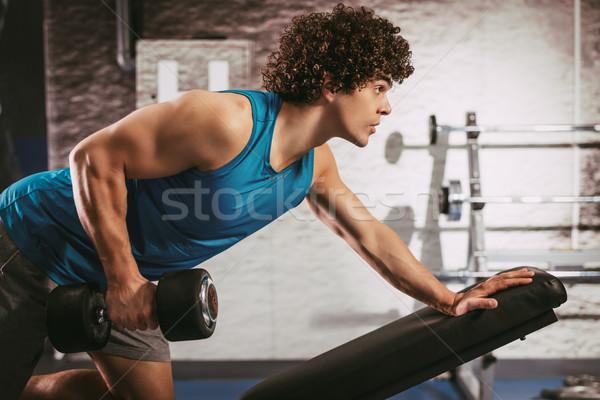 Young Man Exercising At The Gym Stock photo © MilanMarkovic78