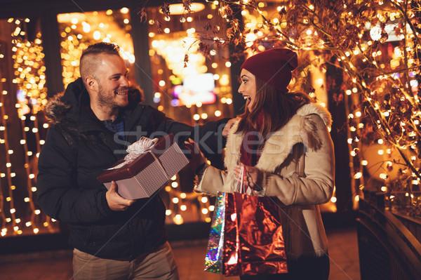 Boldog új évet fiatal gyönyörű derűs pár ünnepel Stock fotó © MilanMarkovic78