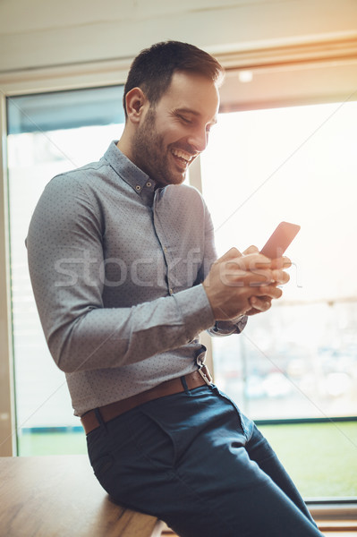 Using His Time Wisely With Smart Technology Stock photo © MilanMarkovic78