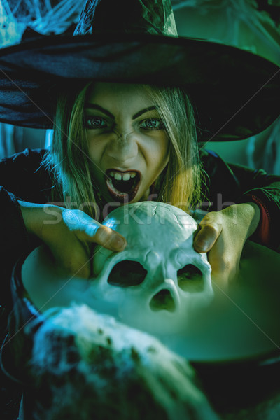 Young Witch Is Cooking Skull Potion Stock photo © MilanMarkovic78