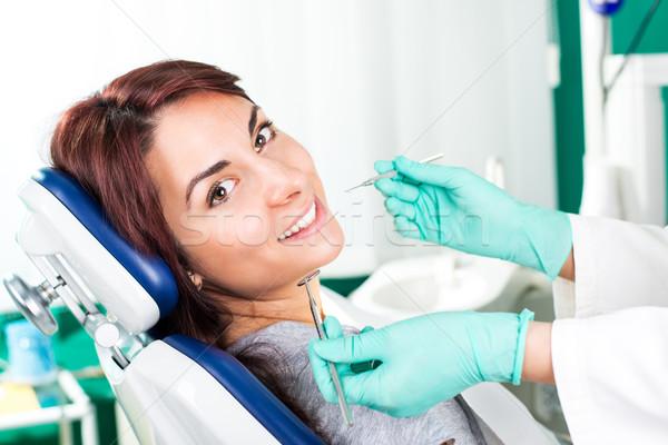 Mosolygó nő fogorvos ül szék kész fogászati Stock fotó © MilanMarkovic78