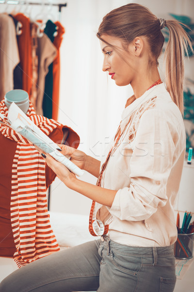 Stock photo: Young Fashion Designer Tailor At Work