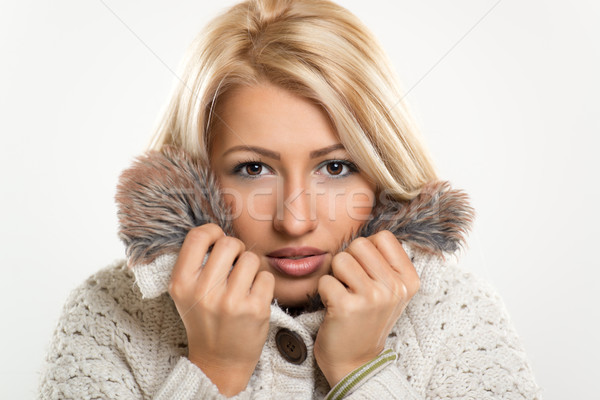 Pretty Girl Tucked In Fur Stock photo © MilanMarkovic78