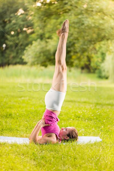 Egzersiz yoga genç kadın park omuz Stok fotoğraf © MilanMarkovic78
