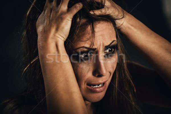Víctima jóvenes mujer miedo mirando Foto stock © MilanMarkovic78