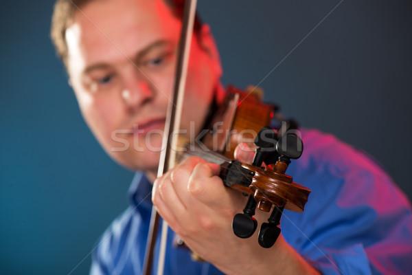 Hegedű közelkép kezek arc ki fókusz Stock fotó © MilanMarkovic78