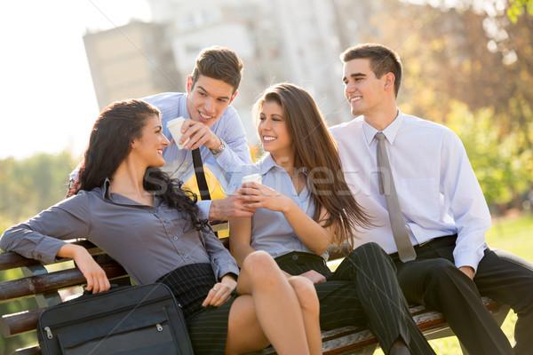 Kávészünet sikeres fiatal üzleti csapat ül park Stock fotó © MilanMarkovic78
