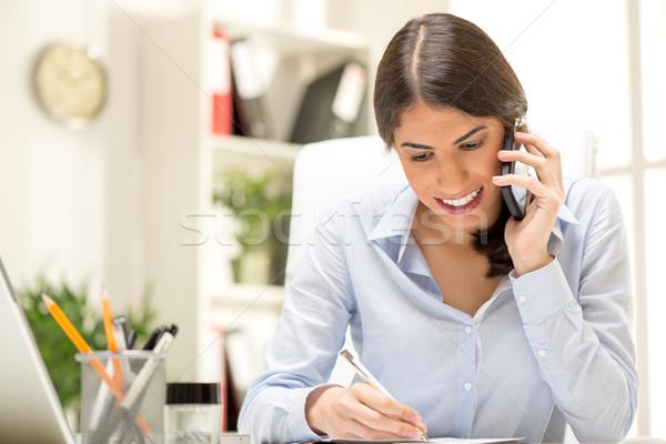 Happy Businesswoman Phoning Stock photo © MilanMarkovic78