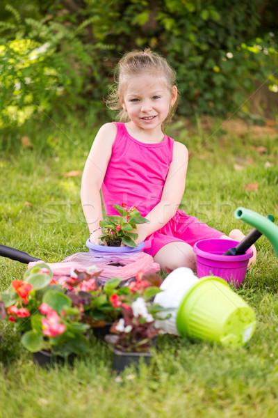 Little girl planting flowers Stock photo © MilanMarkovic78