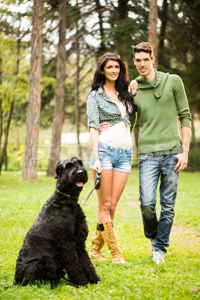 Handsome Couple With Dog Stock photo © MilanMarkovic78