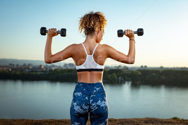 Wysiłek codziennie widok z tyłu młodych kobieta fitness treningu Zdjęcia stock © MilanMarkovic78