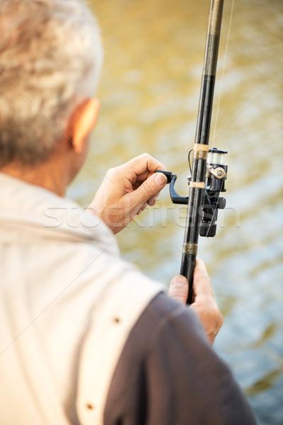 Canne à pêche bobine supérieurs pêcheur eau Photo stock © MilanMarkovic78