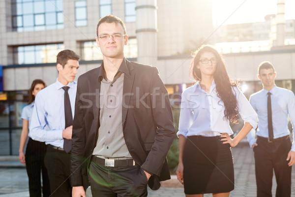 üzleti csapat fiatal áll kívül irodaház néz Stock fotó © MilanMarkovic78