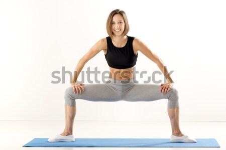 Pretty Young Woman Exercise Stock photo © MilanMarkovic78