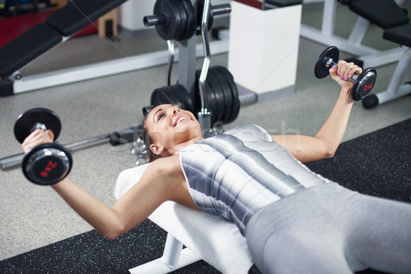 Young woman doing chest exercise Stock photo © MilanMarkovic78