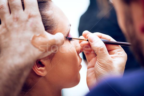Sminkmester közelkép smink férfi művész szemöldökceruza Stock fotó © MilanMarkovic78