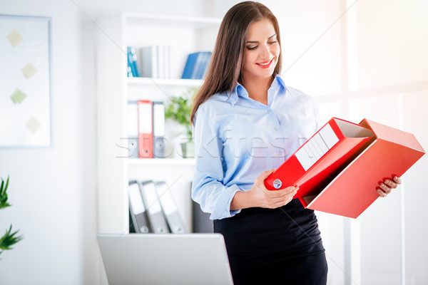 Pretty Businesswoman With Binder Stock photo © MilanMarkovic78