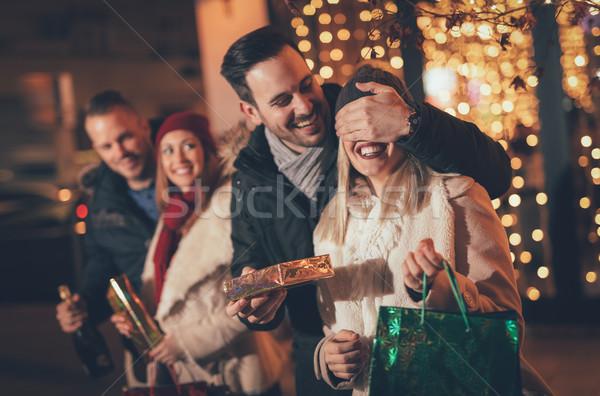 Man Giving Woman A Christmas Surprise Stock photo © MilanMarkovic78