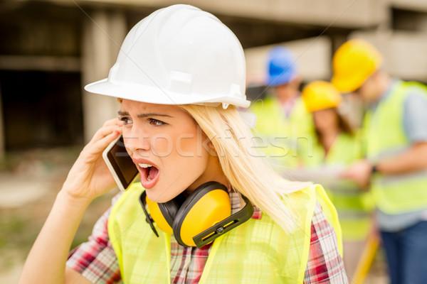 Stockfoto: Vrouwelijke · architect · mooie · jonge · bouw · telefoon