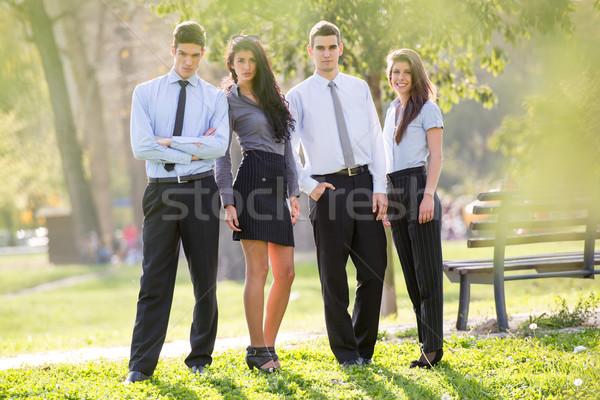 Kollégák park kis csoport üzletemberek áll napos idő Stock fotó © MilanMarkovic78