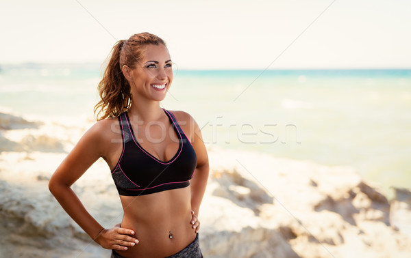 Fitness Girl On The Beach Stock photo © MilanMarkovic78