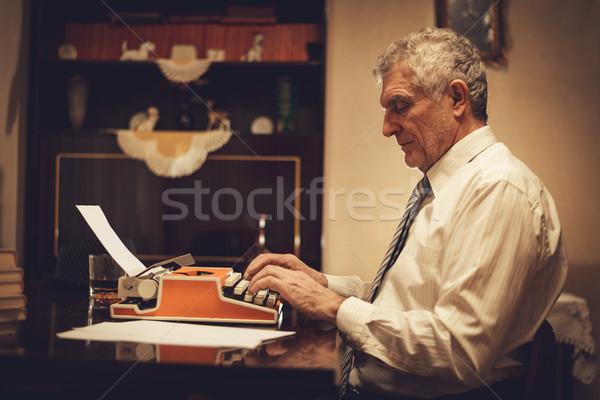 Retro kıdemli adam yazar yazarak Stok fotoğraf © MilanMarkovic78
