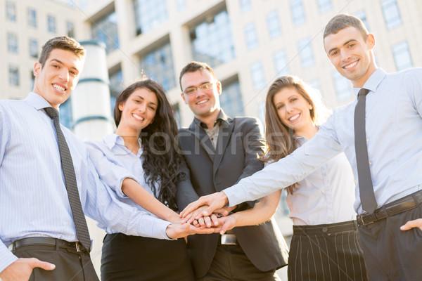Stockfoto: Motivatie · business · kleine · groep · jonge · zakenlieden · permanente