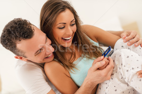 Happy Couple With Pregnancy Test Stock photo © MilanMarkovic78