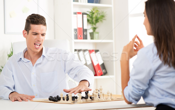 Negocios derrotar jóvenes enojado empresario jugando Foto stock © MilanMarkovic78