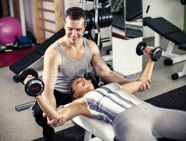 Personal Trainer Assisting A Client Stock photo © MilanMarkovic78