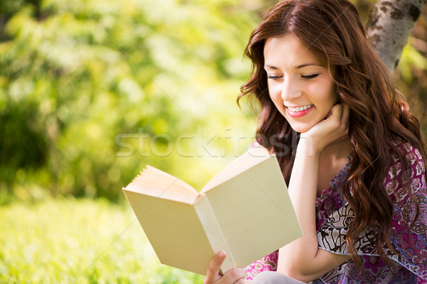 Portrait Of Girl With a Book In The Park Stock photo © MilanMarkovic78