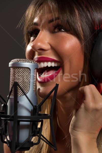 Mutlu kadın şarkıcı mikrofon genç kadın Stok fotoğraf © MilanMarkovic78
