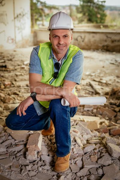 Cabeza construcción arquitecto planes mirando Foto stock © MilanMarkovic78