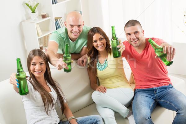 Arkadaşlar bira birlikte ev parti Stok fotoğraf © MilanMarkovic78