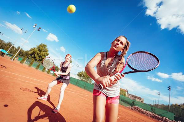 Two Girls Playing Tennis Stock photo © MilanMarkovic78