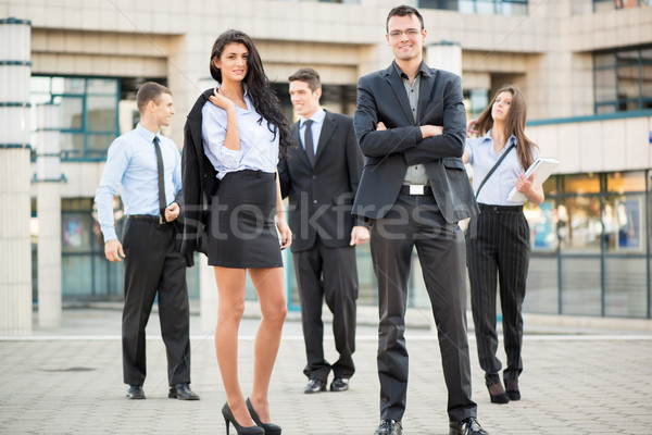 Jóvenes mujer de negocios empresario equipo pie Foto stock © MilanMarkovic78