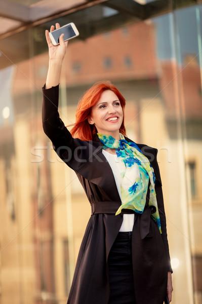 улыбаясь деловая женщина привет счастливым служба Сток-фото © MilanMarkovic78